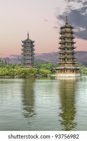 Golden tower and silver tower in the city of Guilin, China