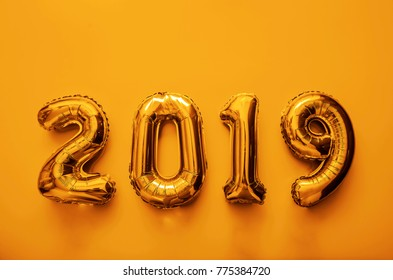 Golden toy balloons isolated on blue background. Happy New Year 2019. photo image icon. empty copy space for inscription or objects