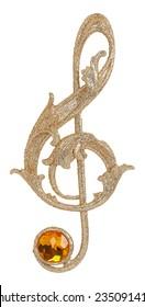 Golden treble clef isolated on white background