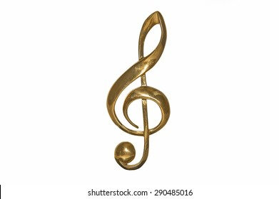 Golden treble clef isolated on a white background