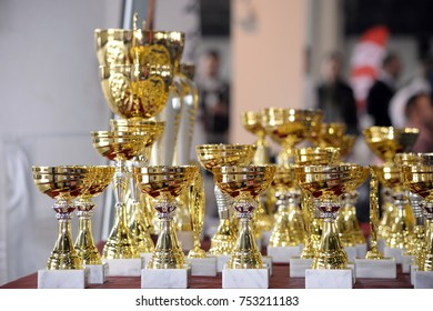 Golden trophies close up photography. Gold award prize. First winner.