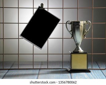 golden trophy and blank postcard clip on the metal wire