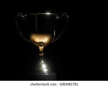 golden trophy on the black background