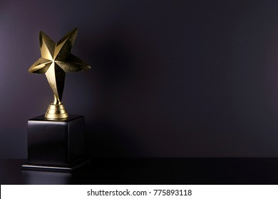 golden trophy on the black background