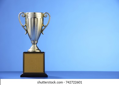 golden trophy on the blue background