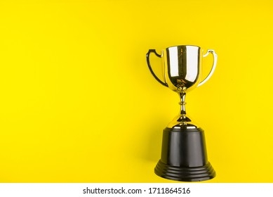 Golden trophy on yellow background.Concept championship.