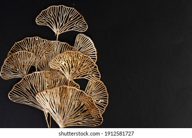 Golden tropical flowers on black background, top view with copy space - Shutterstock ID 1912581727