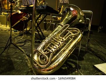 Golden tuba lies on stage
