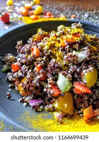 Golden turmeric on my zesty organic black heirloom quinoa salad - chopped heirloom tomatoes, red bell pepper, red onion, celery, juice from 1 lemon, a drizzle of extra virgin olive oil + hemp hearts.