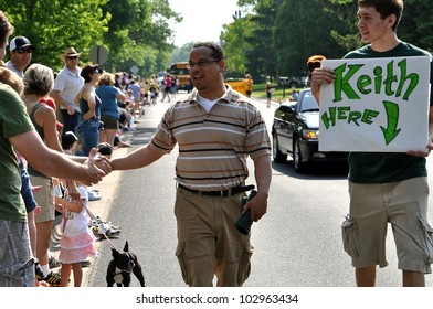GOLDEN VALLEY, MN. - MAY 19:  Congressman Keith Ellison greets parade spectators at the Golden Valley Days Parade on May 19, 2012 in Golden Valley, Minnesota.