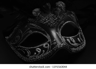 Golden venetian ball mask in front of the night bokeh lights. Masquerade party or holiday event celebration concept, Decorative mask from venice carnival, male and female carnival mask, masquerade