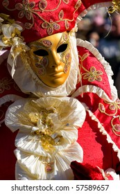 Golden Venetian mask and red costume