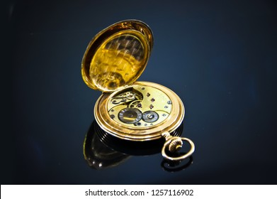 Golden Vintage men's pocket watch chronometer. Vintage pocket watch -symbol of time and space. Gold vintage watches isolated on black background. Beautiful old vintage gold jewelery watches