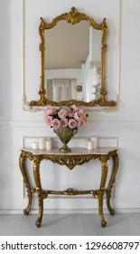 Golden vintage vanity mirror and golden table