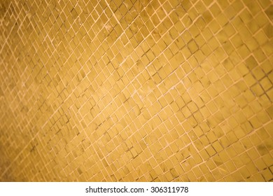 Golden wall in temple in Thailand close up background.