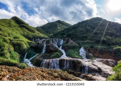 Golden waterfall located in Jin gua shi in Taiwan. Taken with the lens flares from the sunlight