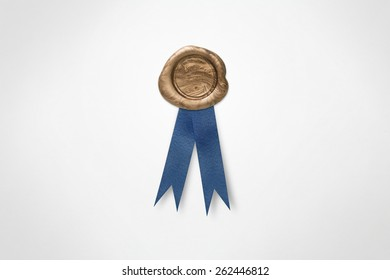Golden Wax Seal and Blue Ribbon Isolated on White (with clipping path)