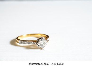 Golden Wedding Ring with Diamond on white background in vivid color filter