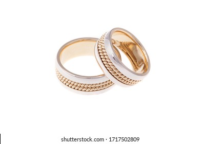 Golden wedding rings, isolated on white