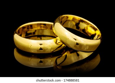 Golden wedding rings on a black  background