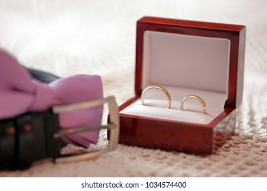 Golden wedding rings on the table before wedding ceremony with space for text
