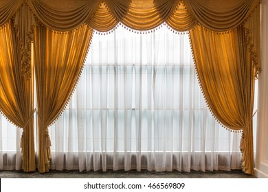 Golden and white see through curtain in luxury style.