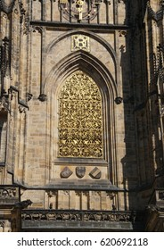 Golden window grate on exterior of   St Vitus Cathedral,  Prague, Czech Republic