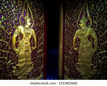 Golden wood carving door in thai temple