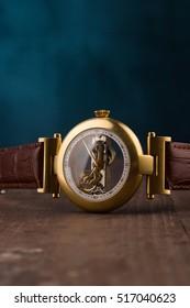 golden wristwatch with transparent dial