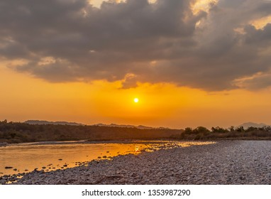 Golden yellow coloration of sky during sunset at Jim Corbett National Park, India