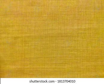 Golden yellow jute fabric texture background. Jute Backdrop.