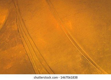 Golden or yellow metal surface texture and background