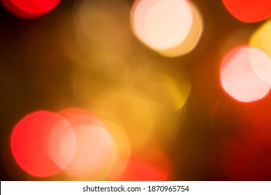 Golden yellow orange and red Christmas lights bokeh, are abstract, used to represent the celebration of Christmas on a festive and fun holiday. (For use background), (dreamy effect edit)