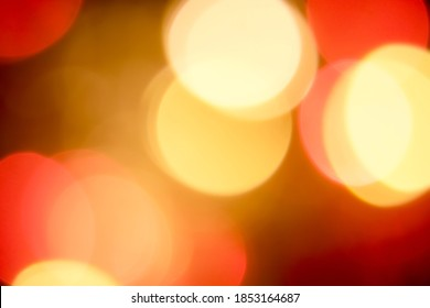Golden yellow and red Christmas lights bokeh, are abstract, used to represent the celebration of Christmas on a festive and fun holiday. (For use background or card design), (dreamy effect edit)