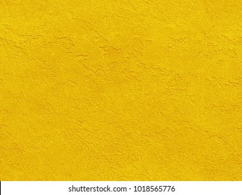 Golden yellow seamless venetian plaster background grunge stone texture. Traditional venetian plaster stone texture grain pattern drawing. Gold grunge texture. Golden seamless stone texture background