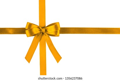 Golden yellow silk ribbon isolated on white background. Festive concept. Flat lay.