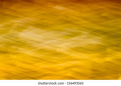 Golden yellow wavy and patterned abstract background.