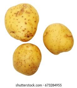 Golden Yukon Potatoes overhead over white.