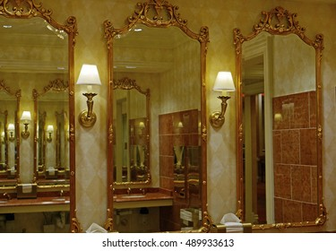 Gold-framed mirrors in a public bathroom