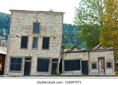 Goldrush heritage buildings in Dawson City, Yukon Territory, Canada, with foundations on melting permafrost making them slant
