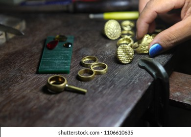 goldsmith checking gold ring after casting
