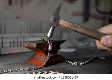 Goldsmith instrument. Anvil and hammer. Craft jewerly tools. Jewelry repair shop. Handmade bracelet