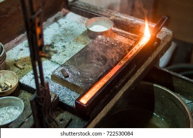 Goldsmith makes gold necklace and jewelry. gold melting process with gasoline burner from bullion gold to gold bar.
