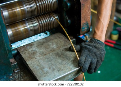 Goldsmith makes gold necklace and jewelry. process gold bar to gold wire with hard machine.