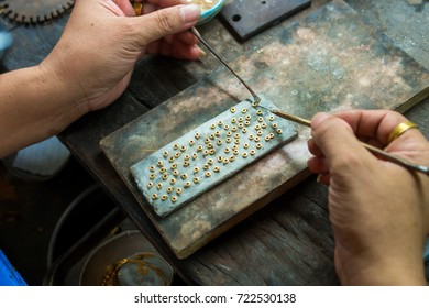 Goldsmith makes gold necklace and jewelry. crafting part of gold necklace