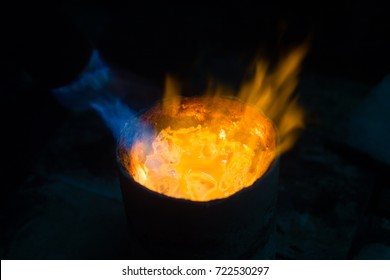 Goldsmith makes gold necklace and jewelry. gold melting process with gasoline burner in crucible. Detail shot with low depth of field.