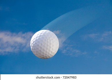 golf ball in the air on a sunny day