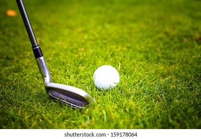 Golf ball before hitting with club from tee on course