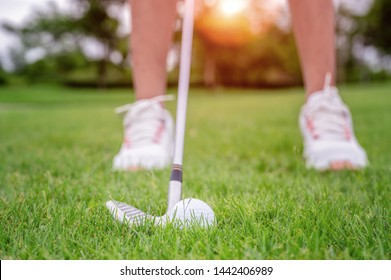 Golf ball being hit or chip by woman golf player from the rough of the fairway to destination winning on the green, target concentrate for winner the score rate
