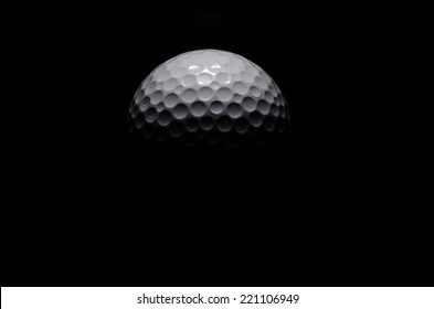 Golf ball in black background
